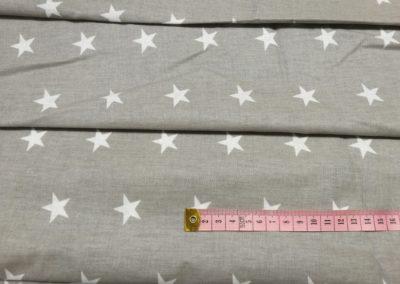 Bawełna wzór białe gwiazdki na szarym