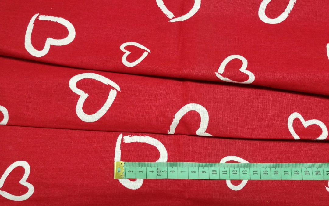 Bawełna wzór białe serca na czerwonym